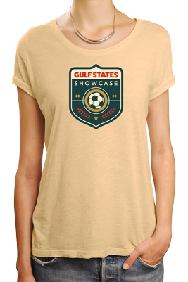 woman wearing pale yellow t-shirt with Gulf States Showcase tournament logo on front