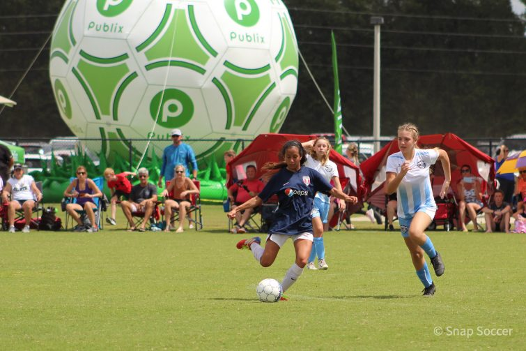 Girls playing soccer at Publix SuperCup