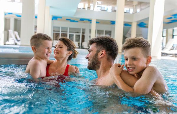 family in hotel pool