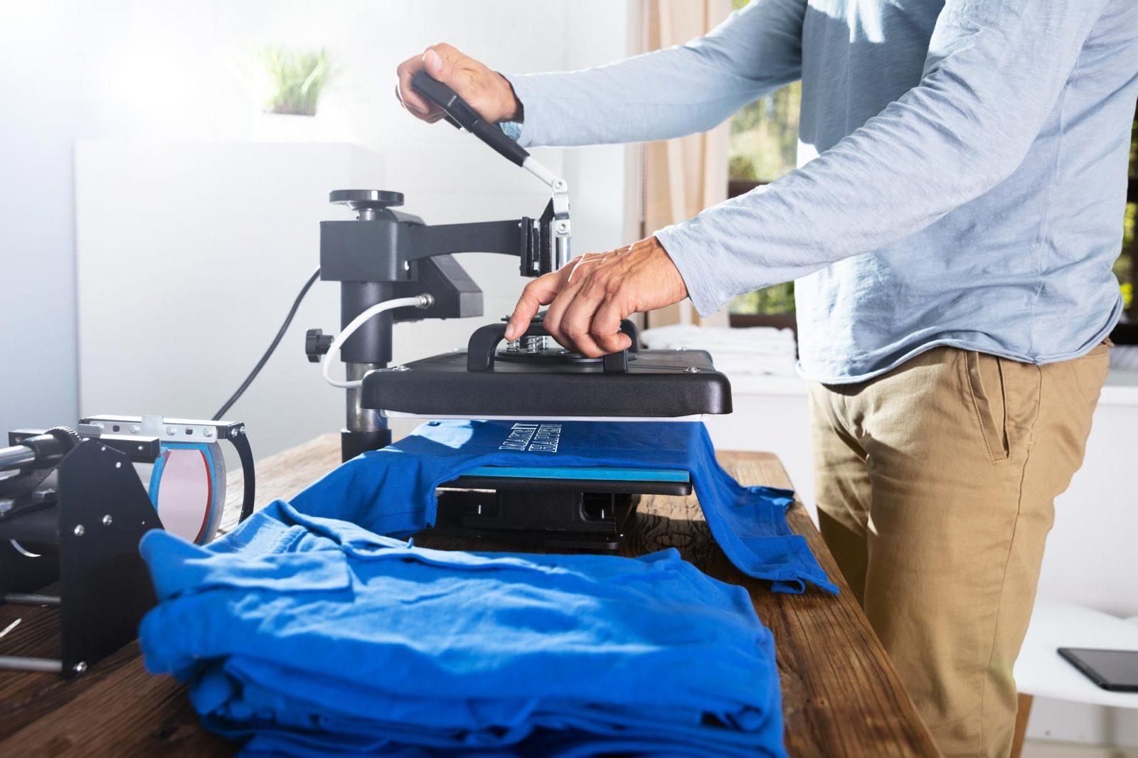 Man heat pressing a shirt